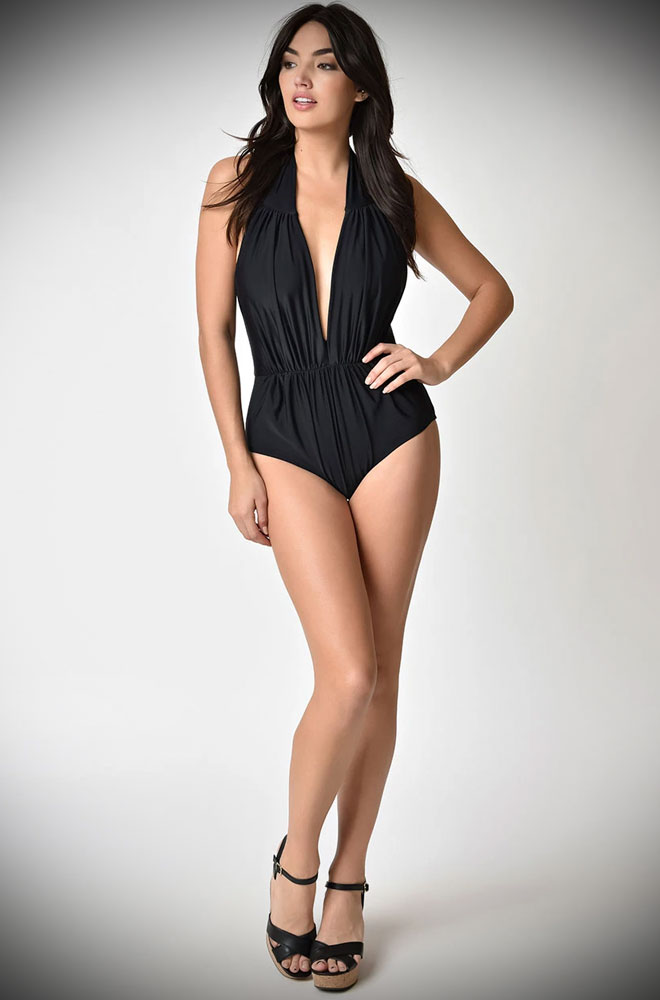 The Black Derek Swimsuit is a sultry and bewitching retro swimsuit. Turn heads in this knockout vintage-inspired swimming costume!