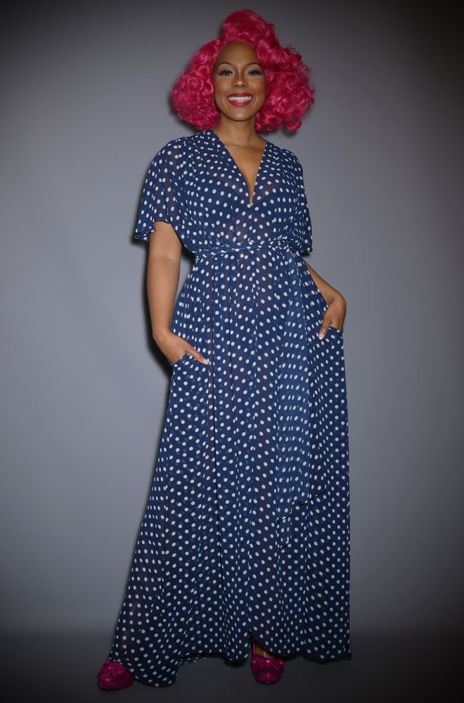 The Navy Polka Dot Claudia Maxi Dress is a draped georgette dress with sash waist. A signature piece by Alexandra King for Deadly.