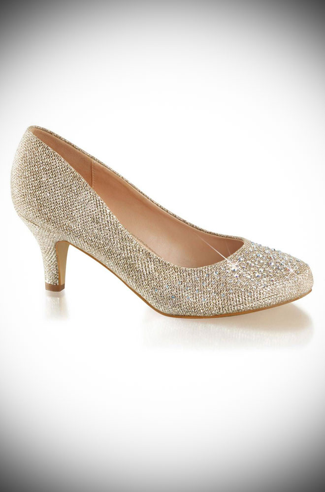 These Doris Shoes are shimmering vintage-style shoes. These sparkling champagne kitten heels glimmer with rhinestone embelishments.