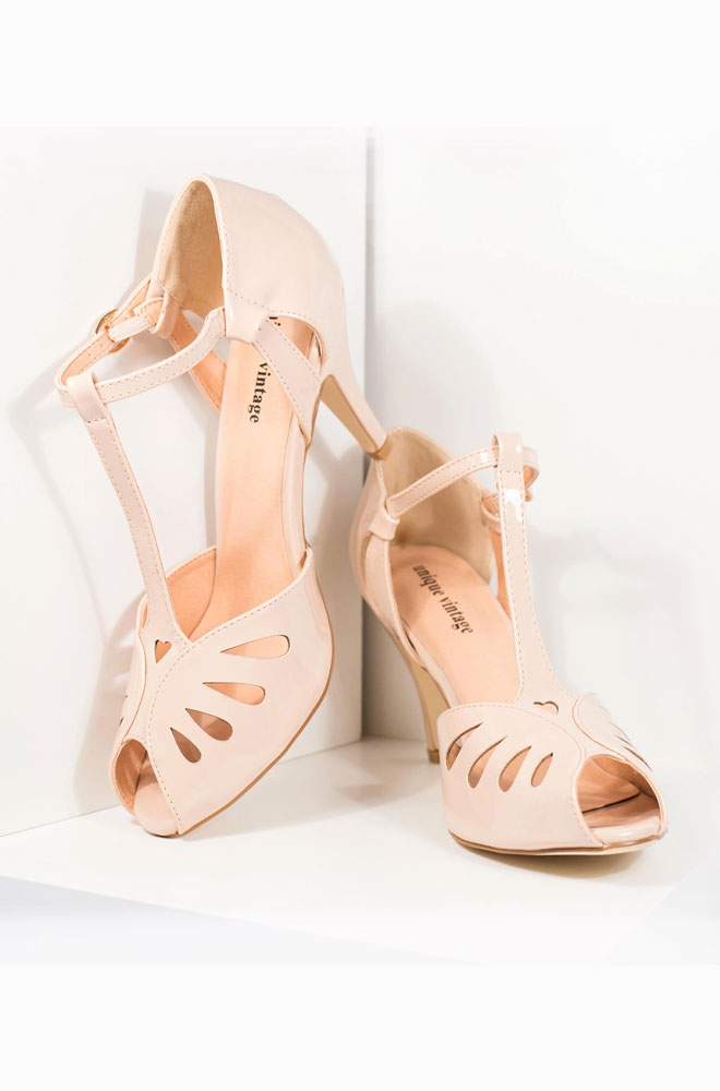 These faux leather Everly Shoes in beige are stunning vintage-inspired pumps. These fabulous T-strap heels feature gorgeous deco detailling.