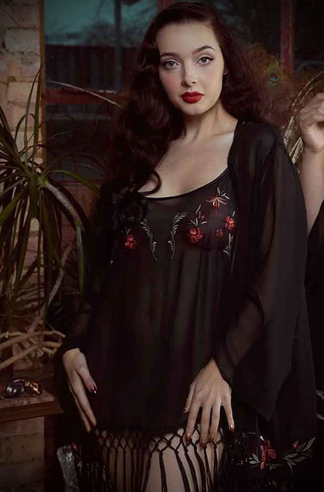 Featuring a floral design embroidered onto sheer mesh, the Bettie Page Embroidered Tassel Chemise will make you feel like the pinup you are.