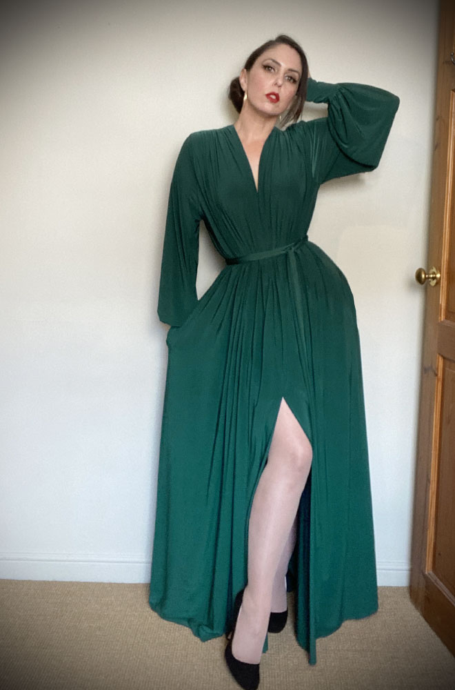 The Green Claudia Gown is a draped jersey evening dress with bishop sleeves. A signature piece by Alexandra King for Deadly is the Female.