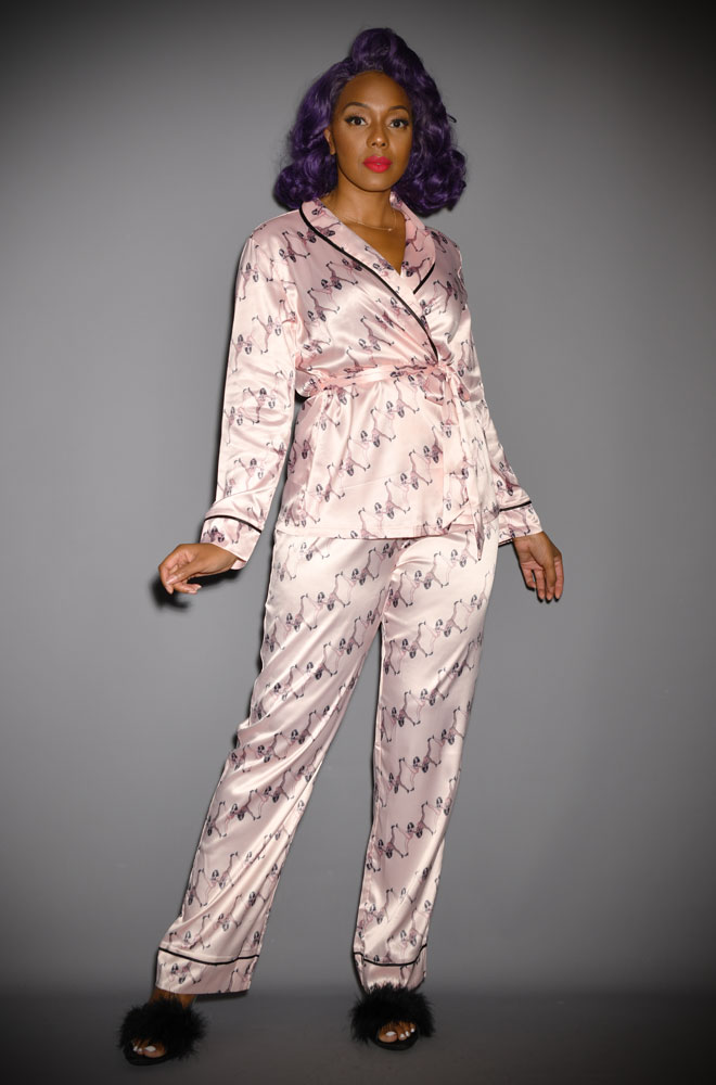 Cosy up in style with the Showgirl Wrap Tie Pyjama Set by Playful Promises. Featuring showgirls dancing across a soft, baby pink satin.