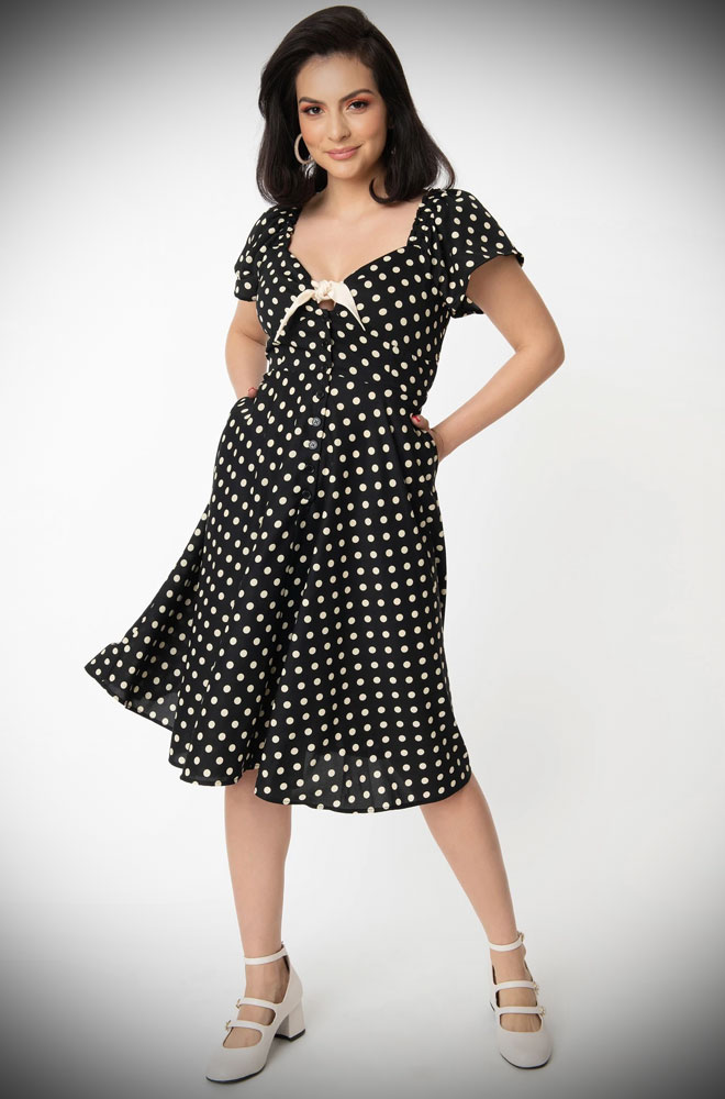 The Ellias Polka Dot Dress is a flirty 50s inspired dress. This romantic and timeless dress is utterly charming.